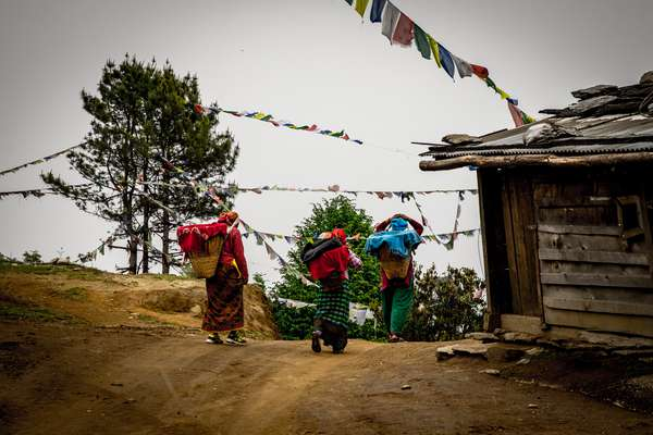 Women carry goods back to their village, Nepal