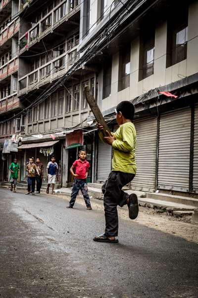 Boys play cricket in the empty streets during the Nepalese elections 2017